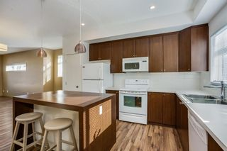 Photo 2: 15 300 EVANSCREEK Court NW in Calgary: Evanston Row/Townhouse for sale : MLS®# A1047505