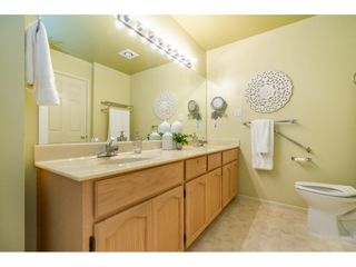 """Photo 23: 106 19649 53 Avenue in Langley: Langley City Townhouse for sale in """"Huntsfield Green"""" : MLS®# R2595915"""