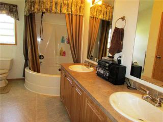"""Photo 11: 19273 WONOWON Road in Fort St. John: Fort St. John - Rural W 100th Manufactured Home for sale in """"WONOWON"""" (Fort St. John (Zone 60))  : MLS®# N230467"""