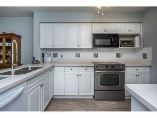 "Photo 9: 208 13860 70 Avenue in Surrey: East Newton Condo for sale in ""CHELSEA GARDENS"" : MLS®# R2160632"