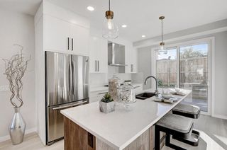 Photo 11: 2119 12 Street NW in Calgary: Capitol Hill Row/Townhouse for sale : MLS®# A1056315