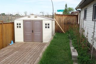 Photo 9: 35 Ranchlands Crescent NW in Calgary: Ranchlands Detached for sale : MLS®# A1115459