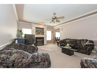 Photo 6: 12321 91A Avenue in Surrey: Queen Mary Park Surrey House for sale : MLS®# F1410080