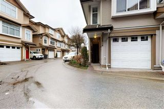 """Photo 1: 201 9580 PRINCE CHARLES Boulevard in Surrey: Queen Mary Park Surrey Townhouse for sale in """"BRITTANY LANE"""" : MLS®# R2552173"""