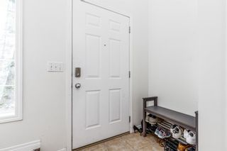Photo 3: 85 Hidden Creek Rise NW in Calgary: Hidden Valley Row/Townhouse for sale : MLS®# A1104213