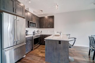 Photo 7: 907 Jumping Pound Common: Cochrane Row/Townhouse for sale : MLS®# A1132952