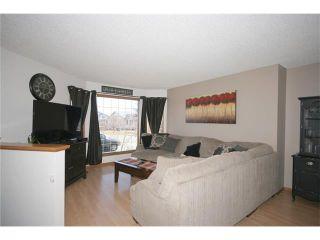 Photo 4: 35 WEST MCDOUGAL Road: Cochrane House for sale : MLS®# C4053037