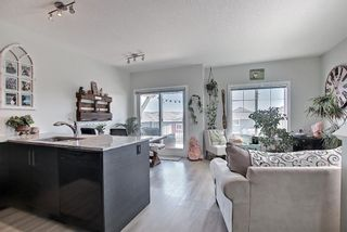 Photo 2: 705 Jumping Pound Common: Cochrane Row/Townhouse for sale : MLS®# A1124366