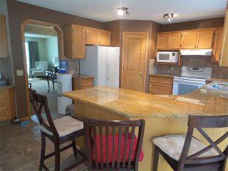 Photo 16: 101 CRYSTALRIDGE Drive: Okotoks House for sale : MLS®# C4019466
