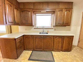 Photo 4: 2904 13 AV NW in Calgary: St Andrews Heights House for sale : MLS®# C4289324