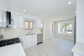 Photo 8: 870 E 58TH Avenue in Vancouver: South Vancouver 1/2 Duplex for sale (Vancouver East)  : MLS®# R2443713