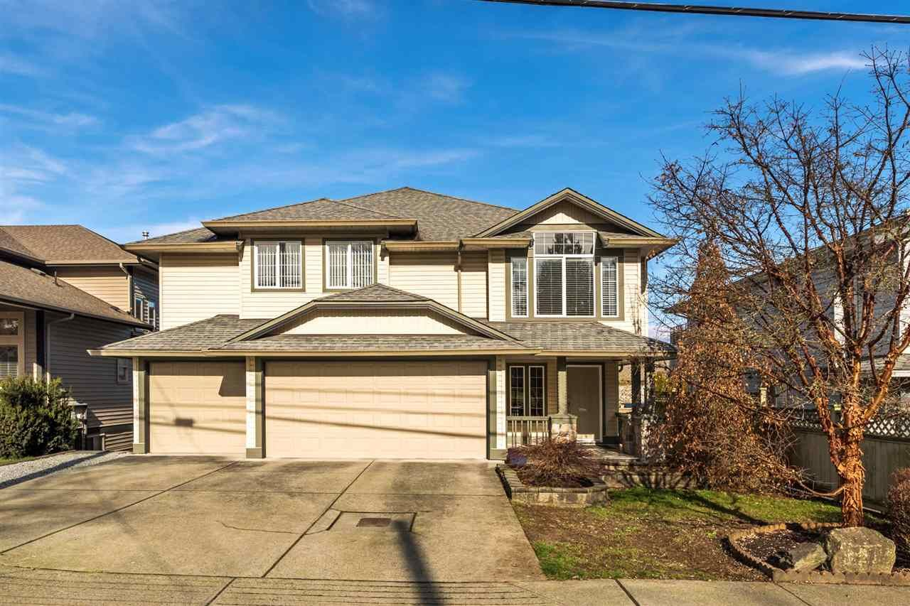 Rare basement entry home with a 3 car garage in West Maple Ridge.