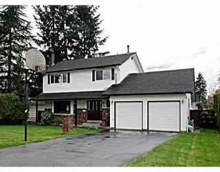 """Photo 1: 820 JARVIS Street in Coquitlam: Harbour Chines House for sale in """"HARBOUR CHINES"""" : MLS®# V633910"""