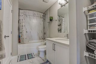 Photo 23: 205 8530 8A Avenue SW in Calgary: West Springs Apartment for sale : MLS®# A1080205