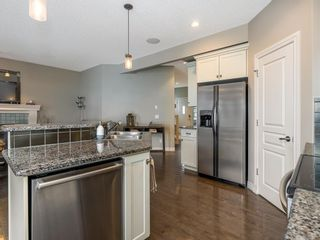 Photo 8: 27 Cougar Plateau Way SW in Calgary: Cougar Ridge Detached for sale : MLS®# A1113604