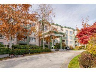 """Photo 1: 125 13880 70 Avenue in Surrey: East Newton Condo  in """"Chelsea Gardens"""" : MLS®# R2419159"""