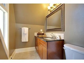 Photo 12: 6 828 COACH BLUFF Crescent SW in Calgary: 2 and Half Storey for sale : MLS®# C3560991