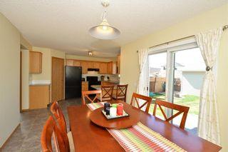 Photo 16: 41 BRIDLERIDGE Gardens SW in Calgary: Bridlewood House for sale : MLS®# C4135340