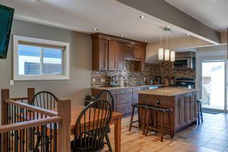 Photo 3: 618 12 Avenue NE in Calgary: Renfrew Detached for sale : MLS®# A1081491