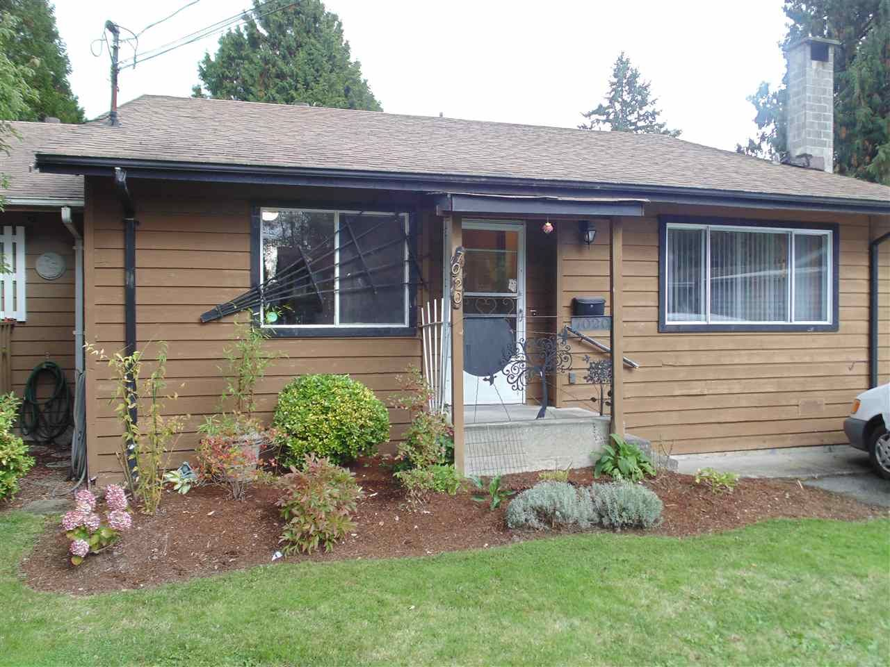 Main Photo: 7020 141 Street in Surrey: East Newton 1/2 Duplex for sale : MLS®# R2408640