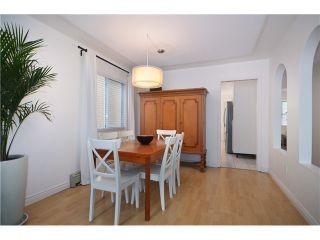 """Photo 5: 878 E 23RD AV in Vancouver: Fraser VE House for sale in """"CEDAR COTTAGE"""" (Vancouver East)  : MLS®# V1022949"""
