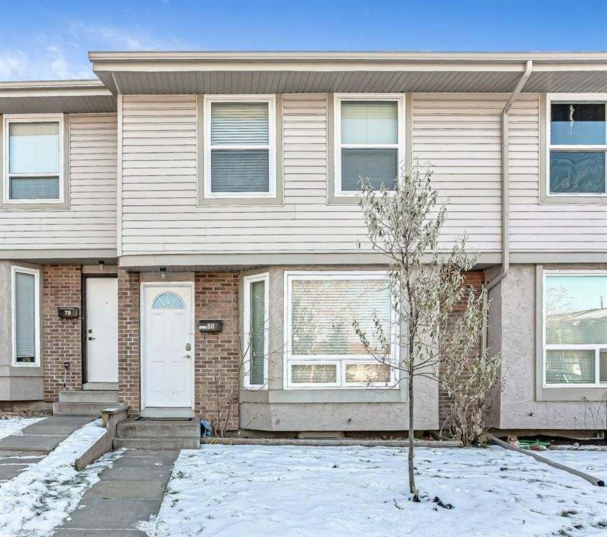 Main Photo: 80 123 Queensland Drive SE in Calgary: Queensland Row/Townhouse for sale : MLS®# A1051877