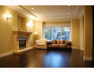 """Photo 5: 1950 E 64TH Avenue in Vancouver: Fraserview VE House for sale in """"FRASERVIEW"""" (Vancouver East)  : MLS®# V785070"""