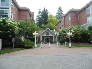 "Photo 1: 409 9668 148 Street in Surrey: Guildford Condo for sale in ""Hartford Woods"" (North Surrey)  : MLS®# R2450892"