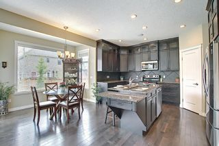 Photo 11: 47 ASPENSHIRE Drive SW in Calgary: Aspen Woods Detached for sale : MLS®# A1106772