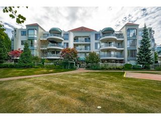 """Photo 1: 201 1705 MARTIN Drive in Surrey: Sunnyside Park Surrey Condo for sale in """"Southwynd"""" (South Surrey White Rock)  : MLS®# R2393853"""