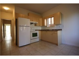 """Photo 12: 7330 ONTARIO Street in Vancouver: South Vancouver House for sale in """"LANGARA"""" (Vancouver East)  : MLS®# V1079801"""