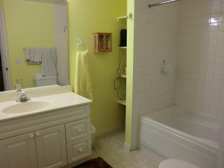 Photo 17: 52 WEST HALL Place: Cochrane Residential Detached Single Family for sale : MLS®# C3553892