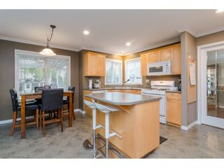 """Photo 6: 18276 69 Avenue in Surrey: Cloverdale BC House for sale in """"Cloverwoods"""" (Cloverdale)  : MLS®# R2369738"""