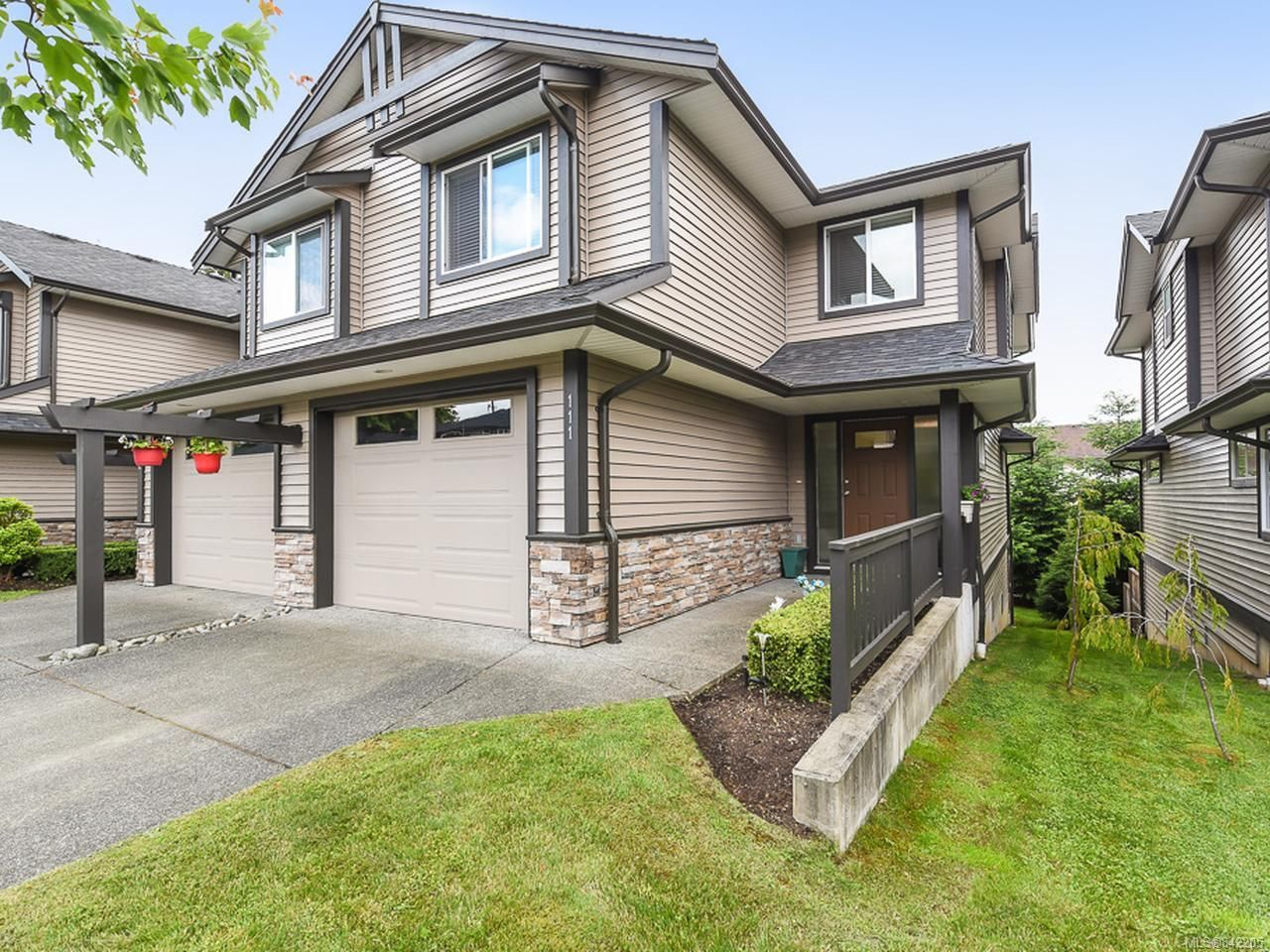 Main Photo: 111 4699 Muir Rd in COURTENAY: CV Courtenay East Row/Townhouse for sale (Comox Valley)  : MLS®# 842205