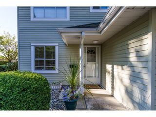 """Photo 2: 101 15439 100 Avenue in Surrey: Guildford Townhouse for sale in """"PLUM TREE LANE"""" (North Surrey)  : MLS®# R2095755"""