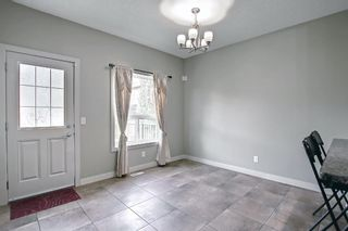 Photo 9: 115 Everhollow Street SW in Calgary: Evergreen Detached for sale : MLS®# A1145858