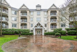 "Photo 1: 215 20894 57 Avenue in Langley: Langley City Condo for sale in ""BAYBERRY LANE"" : MLS®# R2254851"