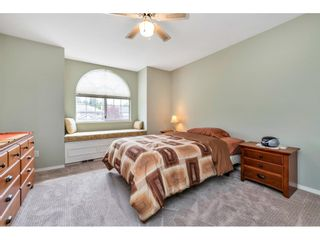 """Photo 16: 6139 W BOUNDARY Drive in Surrey: Panorama Ridge Townhouse for sale in """"LAKEWOOD GARDENS"""" : MLS®# R2452648"""