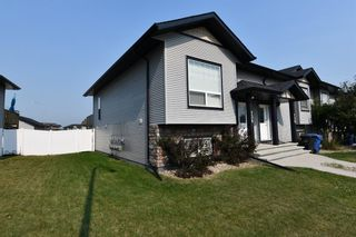 Main Photo: 136 Henderson Crescent: Penhold Row/Townhouse for sale : MLS®# A1130729
