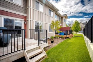 Photo 27: 15 West Coach Manor SW in Calgary: West Springs Row/Townhouse for sale : MLS®# A1100327
