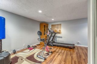 Photo 24: 10 Coach  Manor Rise SW in Calgary: Coach Hill Row/Townhouse for sale : MLS®# A1077472