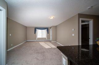 Photo 2: 3308 625 GLENBOW Drive: Cochrane Apartment for sale : MLS®# C4177591