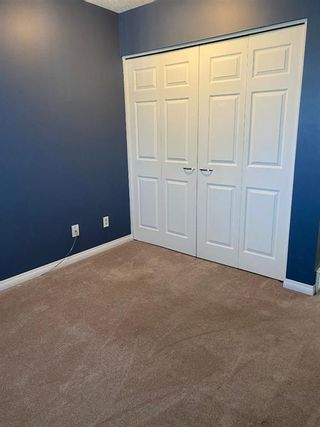 Photo 19: 554 STRATHCONA Drive SW in Calgary: Strathcona Park Semi Detached for sale : MLS®# A1020759