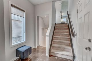 Photo 3: 215 Sunset Point: Cochrane Row/Townhouse for sale : MLS®# A1148057