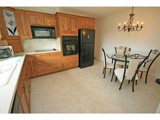 Photo 9: 11 LAKE TWINTREE Place SE in CALGARY: Lake Bonavista Residential Detached Single Family for sale (Calgary)  : MLS®# C3588950