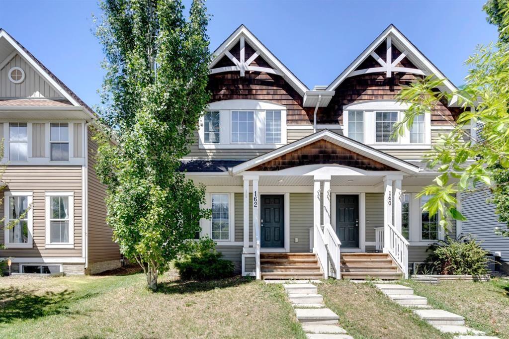 Main Photo: 162 AUBURN BAY Boulevard SE in Calgary: Auburn Bay Semi Detached for sale : MLS®# A1114634