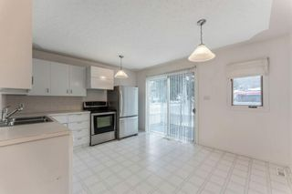Photo 5: 8828 34 Avenue NW in Calgary: Bowness Detached for sale : MLS®# A1075550