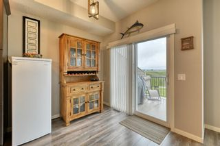Photo 8: 643 101 Sunset Drive N: Cochrane Row/Townhouse for sale : MLS®# A1117436