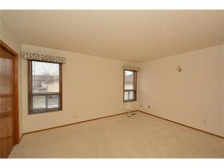 Photo 26: 12 WEST COPITHORNE Place: Cochrane House for sale : MLS®# C4049219