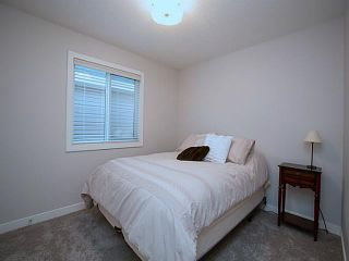 Photo 15: 55 SUNSET Parkway: Cochrane House for sale : MLS®# C3651244